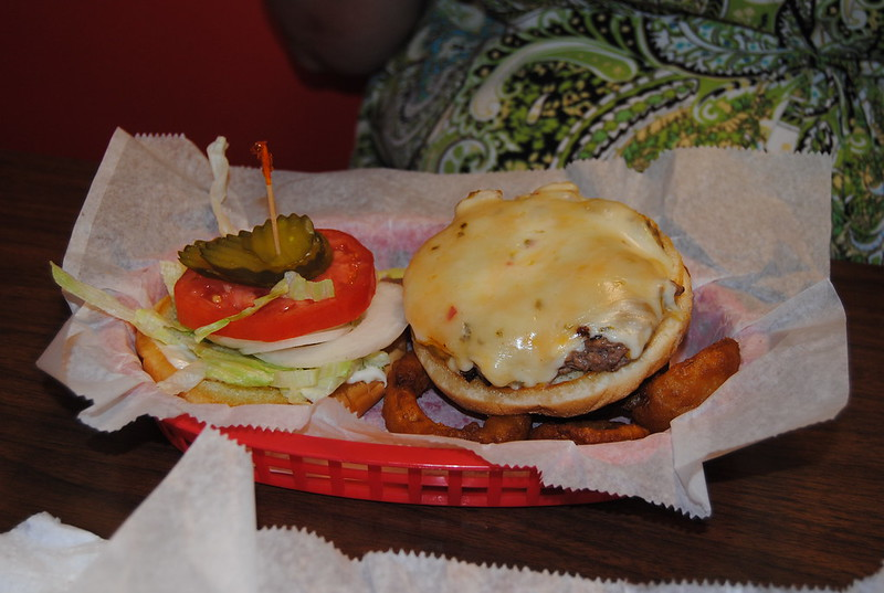 Katherine ordered the 3-Cheese Burger and onion rings.