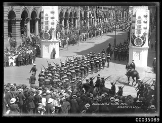 Royal Australian Navy men march through Martin Place for the Victory Parade
