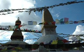 Tibetan Prayer flags on the wind, east side, smaller stupa in the front, Buddha's eyes, Jarung Kashor (bya rung kha shor) the Great Stupa at Boudhanath, Kathmandu, Nepal