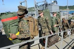 Marines assigned to the 31st Marine Expeditionary Unit embark USS Bonhomme Richard (LHD 6). (U.S. Navy/MC3 Naomi VanDuser)