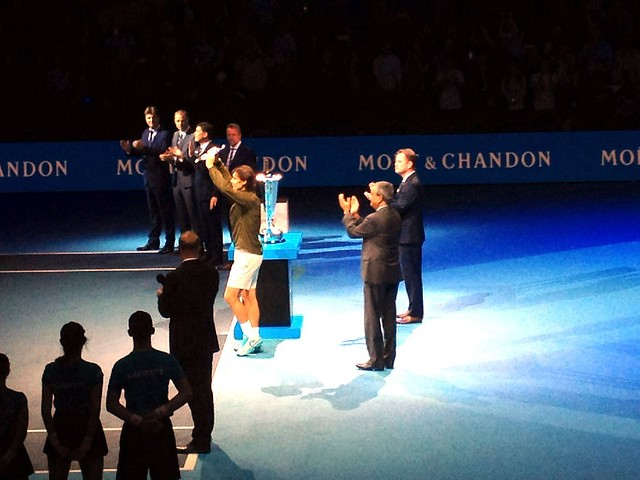 Rafal Nadal picks up his trophy at the ATP World Tour Finals