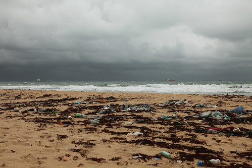 Thunderclouds and rubbish, Ilado Beach, Lagos, Nigeria | by Yozhik66