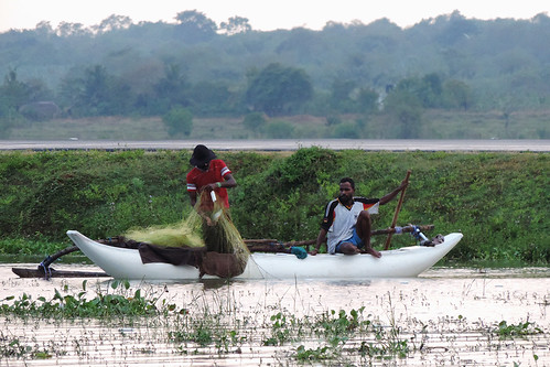 travel ceylon uva uvaprovince wetlands srilanka grasslands southasia asia lake weerawilalake outdoor landscape water sky sunset bright colour purple red blue people fishermen boat net dnysmphotography dnysmsmugmugcom