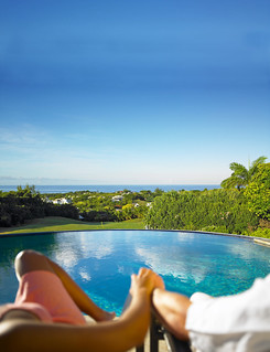 Couple by the pool - Royal Westmoreland estate, Barbados