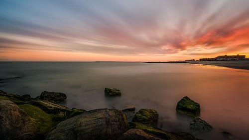 ocean camera nyc longexposure sunset sky sun newyork beach nature colors clouds landscape photography sand nikon rocks long exposure flickr outdoor tokina dslr digitalslr rockawaybeach rockaways 1116 d7100 towfiqahmed
