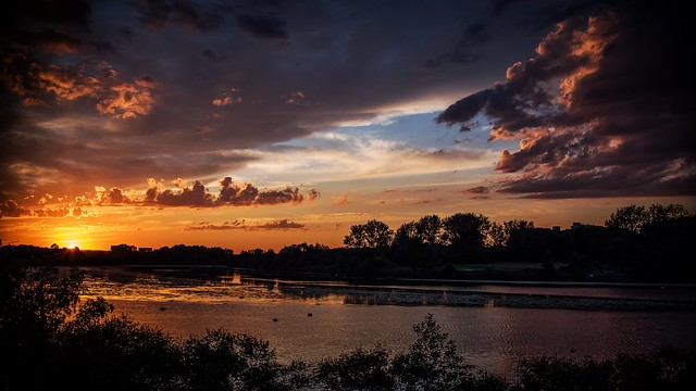 A sunset spectacular over the Mystic River.