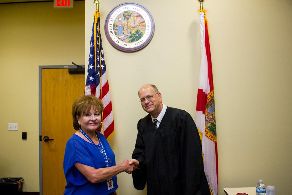 Chief Judge Jonathan Sjostrom and a newly sworn in volunte