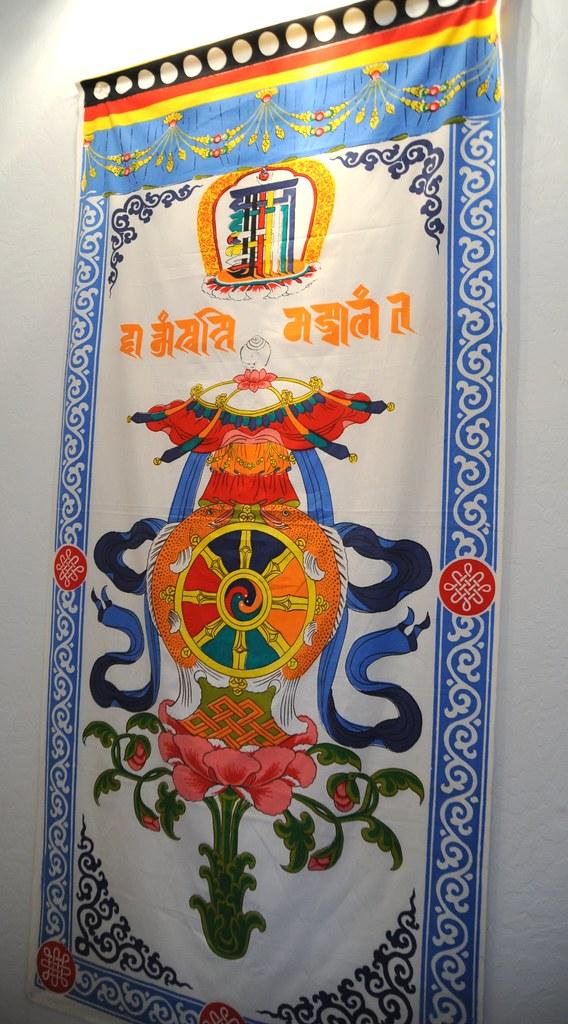Tibetan door cover: Kalachakra symbol with the 8 Auspiciou