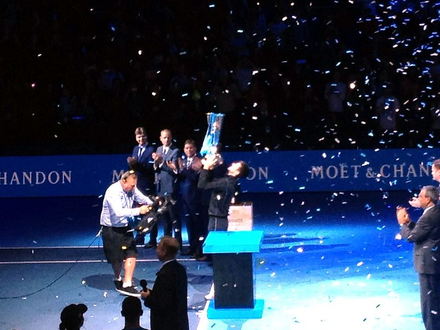 Champion Novak Djokovic collects his trophy at the ATP World Tour Finals