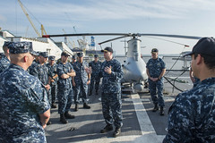 Capt. Fred Kacher, Destroyer Squadron 7 commodore, speaks with LCS Crew 103 and LCS Crew 104 during a change of command ceremony aboard Fort Worth (LCS 3), Feb. 17. (U.S. Navy/MC2 Conor Minto)