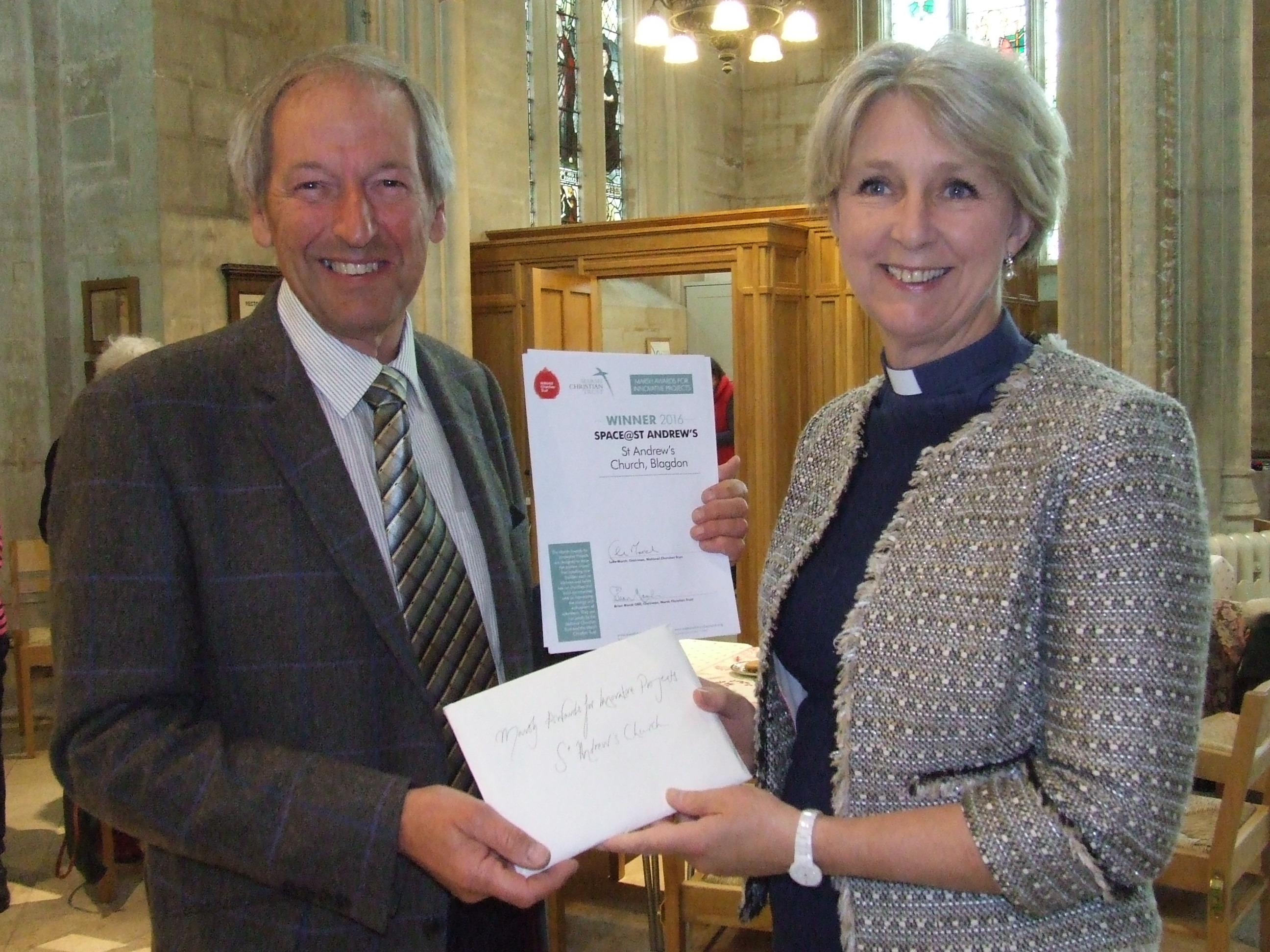 Chris Hawkings of the Somerset Historic Churches Trust presents Rev Jane Chamberlain, Rector of St Andrew's Blagdon, with the winner's certificate (c Ros Anstey)