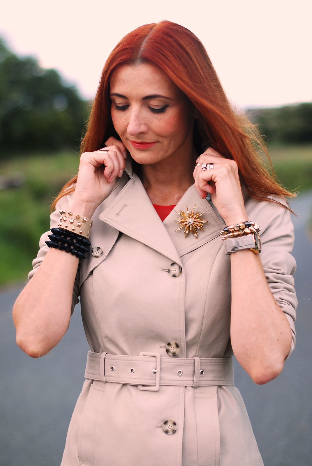 Classic trench coat with gold starburst brooch | Not Dressed As Lamb