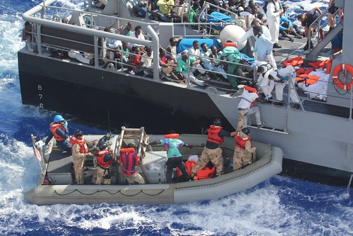 Distressed persons are transferred to a Maltese patrol vessel. | by Official U.S. Navy Imagery