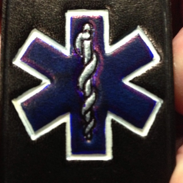 EMS Star of Life on a radio strap.