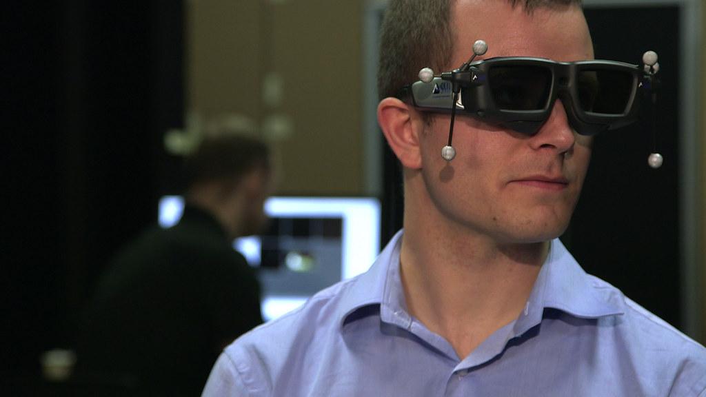 Erik with SMI eye tracking glasses | eyetracking-glasses com