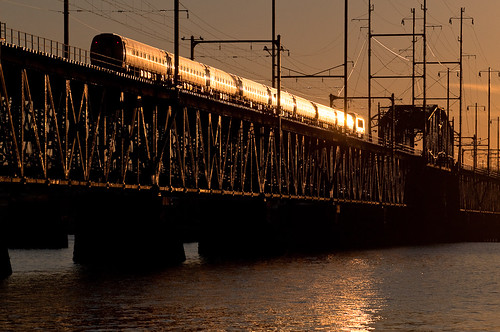bridge sunset reflection electric train river photo maryland 71 amtrak locomotive passenger decor regional glint susquehanna perryville amtk amfleet hhp9