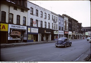 VW Beetle driving past the Isaacs Gallery on Yonge Street, north of Cumberland Street | by Toronto History