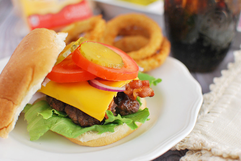 Classic Cheeseburger - the best way to make a classic cheeseburger! Top it with bacon, cheese, tomatoes, lettuce, pickles, and the condiments of your choice.