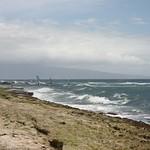 Wind surfing near the rocks, Maui