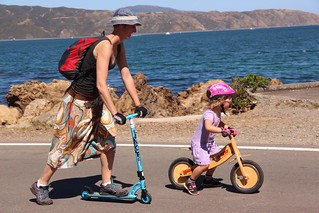 Mum in scooter support of young cyclist