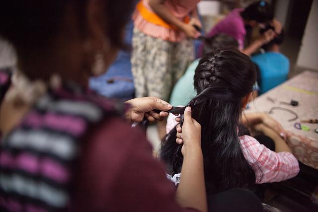Stock shot from Redlight Greenlight of girl having her hair plaited