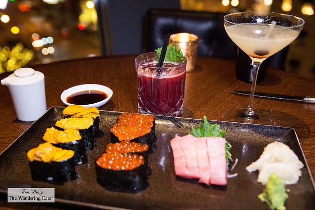 Our sushi selection (uni, ikura, and chutoro (fatty tuna)) with our cocktails