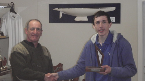 Andrew Coffin receiving the Secretary Junior Trophy for 1st Junior Placing in the Mad Hatter Regatta | by PLSC (Panmure Lagoon Sailing Club)