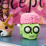This guy's cute brain comes off to reveal a compartment. Made by Addie Hall, Deceptions