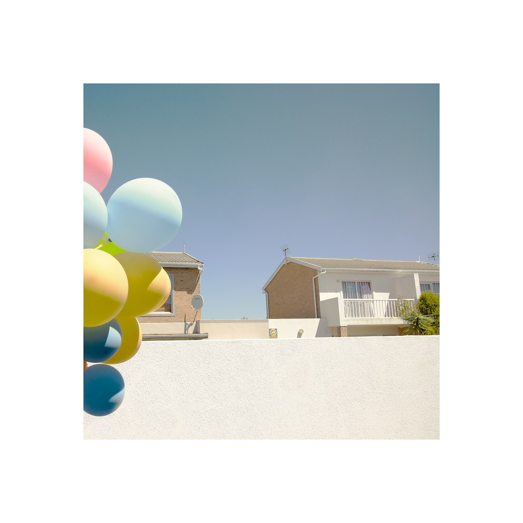 Balloons, walls, sky and tree.