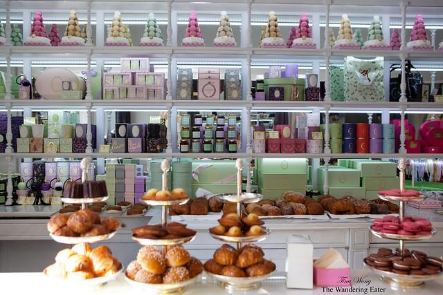 Shelves of Ladurée boxes amongst the pastries
