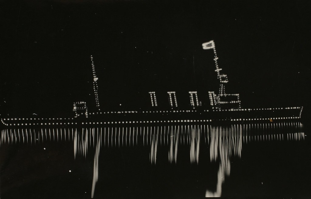 HMAS Sydney illuminated at night during the week after the entry of the first Royal Australian Navy Fleet into Sydney Harbour October 4 1913