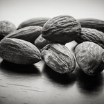 still life: almonds on wood