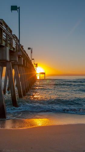 blue sky orange sun yellow catchycolors coast sand waves seascapes scenic silhouettes sunsets fav20 beaches sunburst blueskies oceans sunsetlight fav15 goldenhour sunbeams settingsun gf1 fav10 views500 views200 views400 views300 beachphotography sunsetmadness sunsetsniper