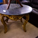 Antique black marble circular coffee table