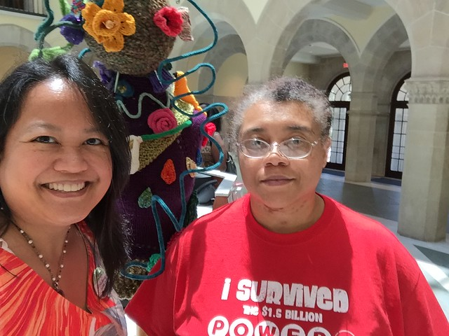Juanita and I posing in front of the Yarn Bomb on WWKIP Day 2016 at The Chrysler Museum of Art