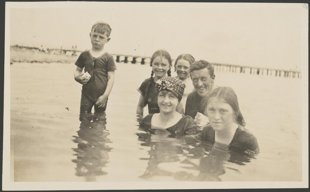 Molly Fink with a man and four children swimming in the ocean at Portarlington [?] , Victoria, ca. 1914