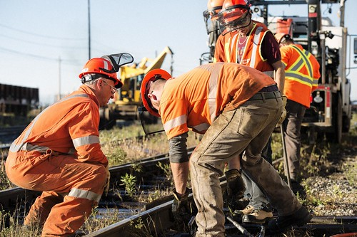 Male Construction Workers Working on Tracks / Travailleurs de la construction travaillant sur les rails