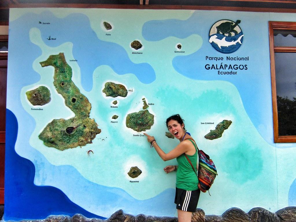 Flora pointing at map of Galápagos Islands, Ecuador | Flickr on puerto ayora, pinta island, amazon map, puerto baquerizo moreno, yucatan peninsula map, brazilian highlands map, cuba map, oman map, isabela island, bahamas map, lesser antilles map, ha long bay, genovesa island, puerto rico map, charles darwin research station, nameless island, greenland map, galapagos national park, cape horn map, strait of magellan map, patagonia map, japan map, darwin island, ecuador map, bay of fundy, pampas map, canada map, tierra del fuego map, pacific map, fernandina island, baltra island, lake titicaca map, floreana island, falklands map,