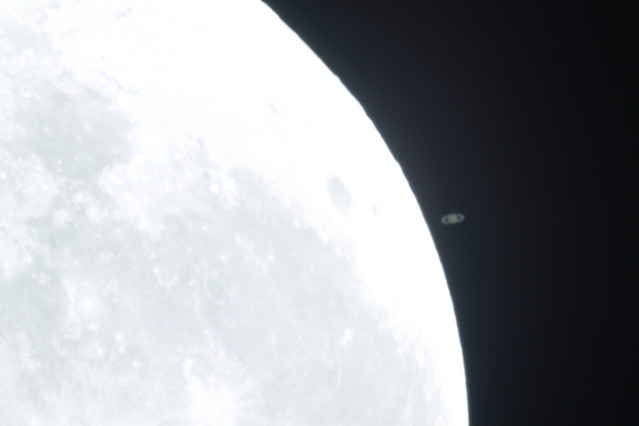 Saturn moving slowly closer to the Moon