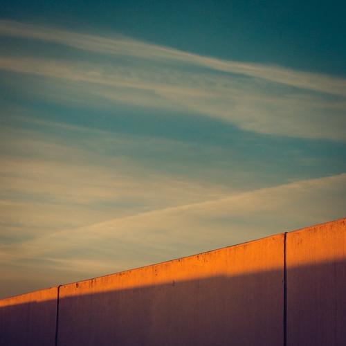 rooftop clouds sunrise concrete garage parallel
