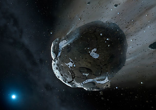 Artist's view of watery asteroid in white dwarf star system GD 61 | by Hubble Space Telescope / ESA