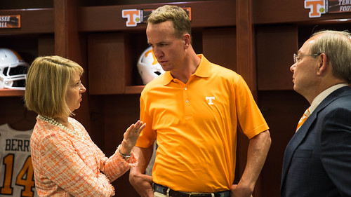 Provost Martin and Chancellor Cheek talk with noted alum Peyton Manning.