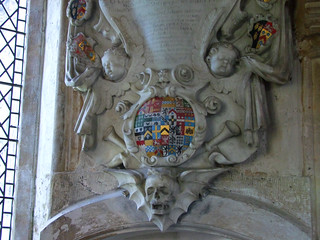 two cherubs, a winged skull and trumpets