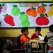 Children sit at their desk at the El Renacimiento Municipal School