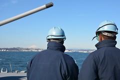 Sailors aboard USS Lassen (DDG 82) observe Mt. Fuji as the ship departs Yokosuka. (U.S. Navy/Lt. j.g. Lauren Chatmas)