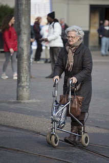 Old silver lady behind silver wheeled walker (rollator) on tram rails | by Marcel Oosterwijk