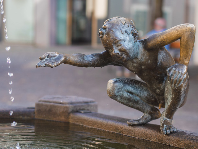 Sculpture on a fountain in Ortisei