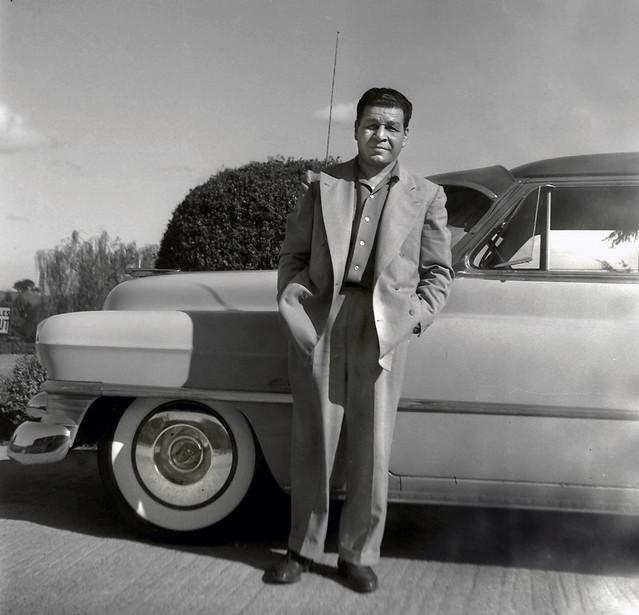 Man with Cadillac c1953
