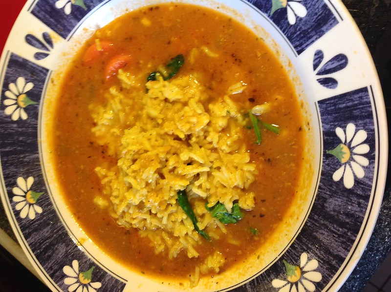 Tomato soup with coconut curry rice