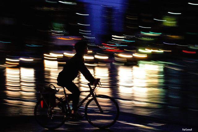 Cyclist navigates the slippery streets of Toronto